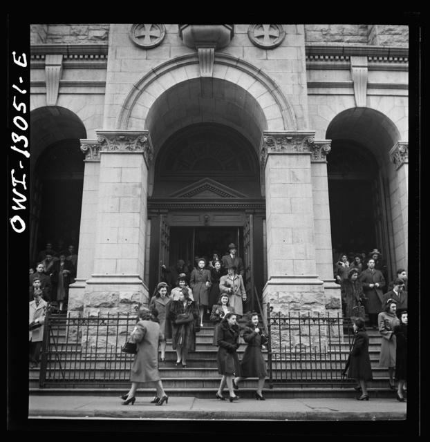 New York, New York. Italian-Americans coming out of Saint Dominick's church on Sullivan Street on New Year's Day