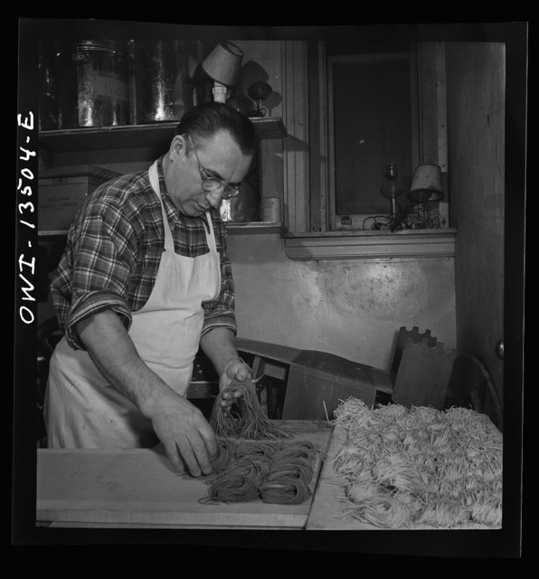 New York, New York. Laying out portions of freshly-made green and white noodles in the kitchen of the Sixty-Eight restaurant on Fifth Avenue at Thirteenth Street. Each pile represents a portion