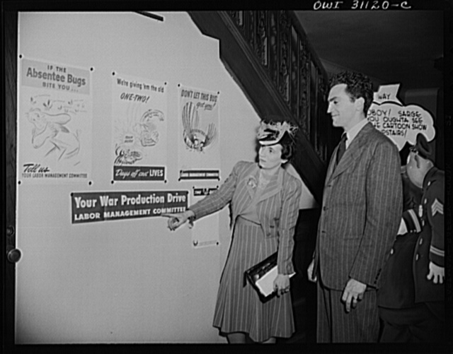 New York, New York. Miss Anna Rosenburg of the War Manpower Commission, and Louis Priscilla, a Chairman of the Committee on War Cartoons of the American Society of Magazine Cartoons, at the exhibition of cartoons concerning lost hours in war production sponsored by the OWI (Office of War Information)