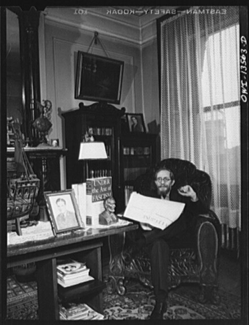 New York, New York. Mr. Raymond Fazio, journalist, in his home on East Tenth Street. He has four sons in the United States Army. A portrait of one is on the table; another on the bookcase. Note book in bookend representing Abraham Lincoln
