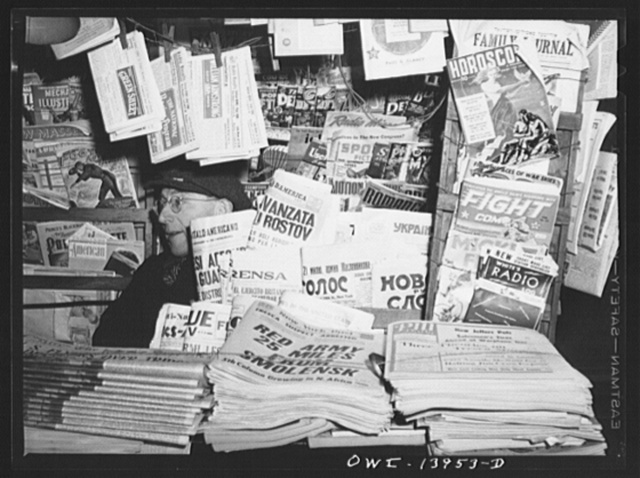 New York, New York. Newsstand on Fourth Avenue at Fourteenth Street which sells foreign language newspapers