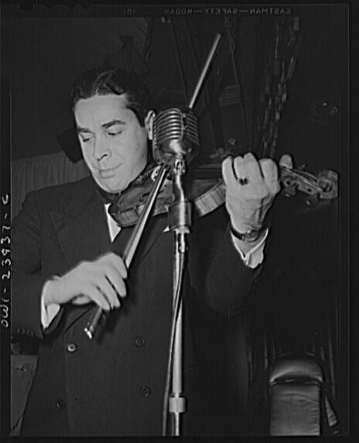 New York, New York. Orchestra leader who fills in for Duke Ellington at the Hurricane