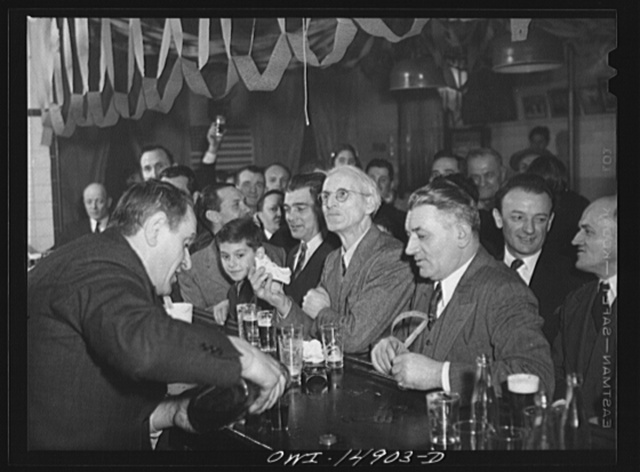 New York, New York. Saturday night gathering of the members of the Venetia Giulia fraternity, an International Workers' Order section made up of Italians from the southern section of Austria. The organization gives them sickness insurance and other benefits. Drinking beer at a bar adorned with portraits of Lincoln and Roosevelt