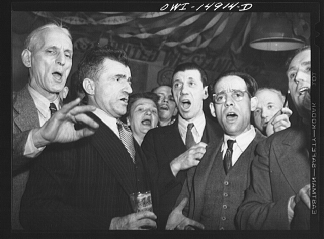 New York, New York. Saturday night gathering of the members of the Venetia Giulia fraternity, an International Workers' Order section made up of Italians from the southern section of Austria. The organization gives them sickness insurance and other benefits. Austrian-Italian-Americans singing songs of their native country