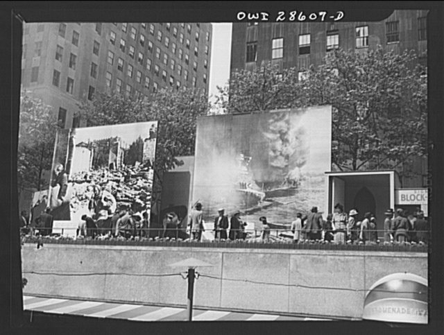 New York, New York. Spectators attracted by the exhibits at the Nature of the Enemy show, put up by the United States OWI (Office of War Information) at Rockefeller Plaza