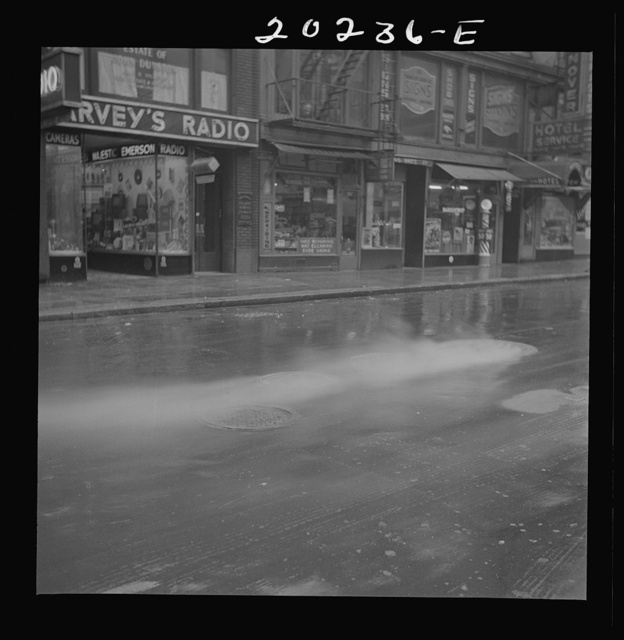New York, New York. Steam rising from the pavement on a rainy day