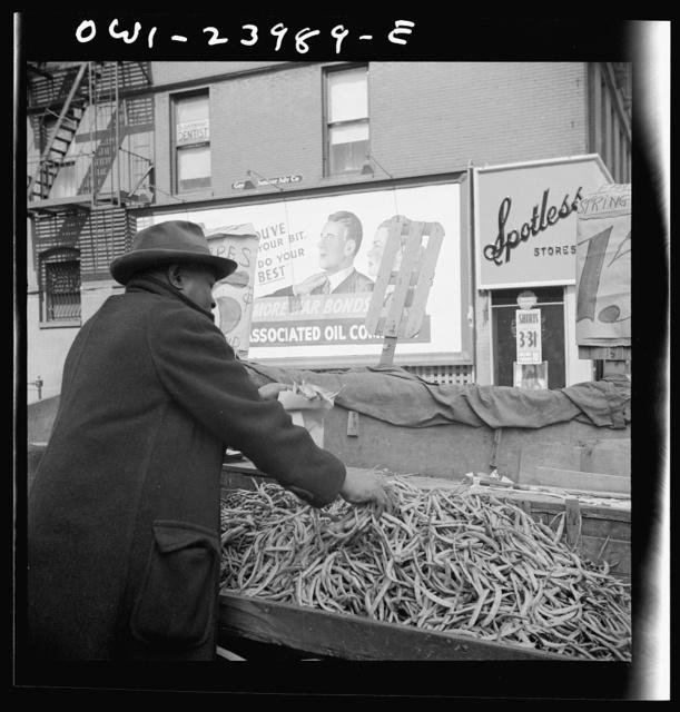 New York, New York. Street peddler in the Harlem section