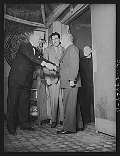 New York, New York. The head waiter of the Hurricane greets Leo Robbins, songwriter, and his party
