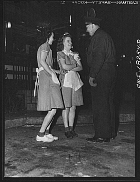 Newcastle (vicinity), Delaware. Truck driver talking with waitresses at the diner where he has stopped for dinner along U.S. Highway 40