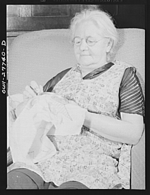 Niagara Falls, New York. Mrs. Hannegan, who runs a boardinghouse for girls who work in war plants, sewing