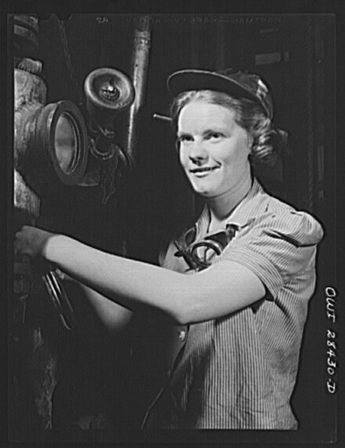 Niagara Falls, New York. Nan Hannegan a nineteen year old chemical operator at the Niacet chemical company, earning thirty-nine dollars a week, taking readings from dials and thermometers