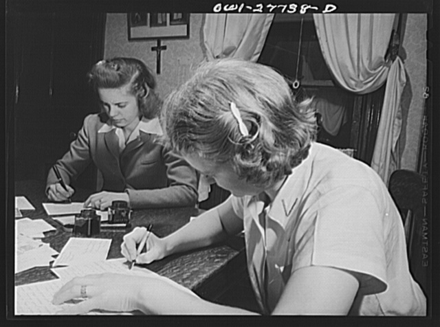 Niagara Falls, New York. Nan Hannegan, a nineteen-year old chemical operator at the Niacet chemical company, and a friend writing letters