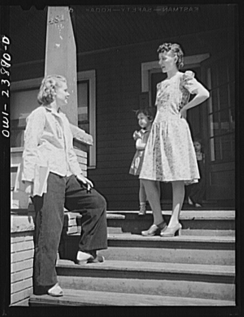 Niagara Falls, New York. Nan Hannegan doing door to door recruiting for women to work in war plants. This program was organized by the War Manpower Commission in cooperation with local war plants who loaned nineteen women workers