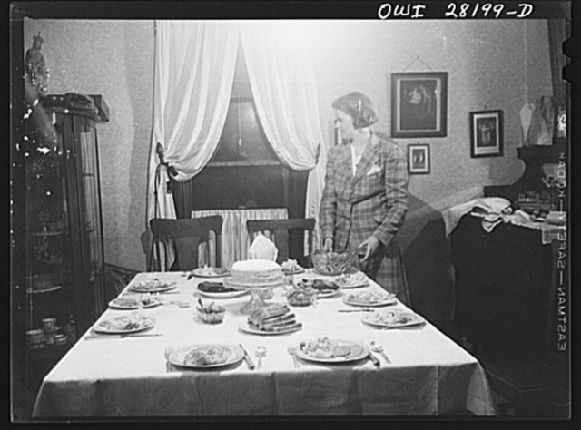 Niagara Falls, New York. The table is set for a midnight supper at Nan Hannegan's twentieth birthday party, at her mother's house where girl war workers board