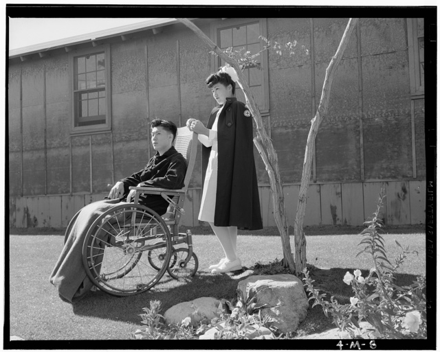 Nurse Aiko Hamaguchi, patient Tom Kano, Manzanar Relocation Center, Calif. / photograph by Ansel Adams.