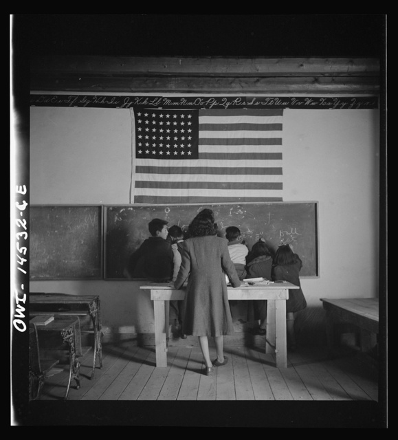 Ojo Sarco, New Mexico. One-room school in an isolated mountainous Spanish-American community, which has eight grades and two teachers. The teachers have little equipment with which to work and the ABCs, penmanship, and grammar are taught on the blackboard