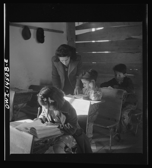Ojo Sarco, New Mexico. One-room school in an isolated mountainous Spanish-American community, which has eight grades and two teachers. Most of the teaching is in Spanish, the language spoken in the children's homes, and as a result they rarely speak English fluently