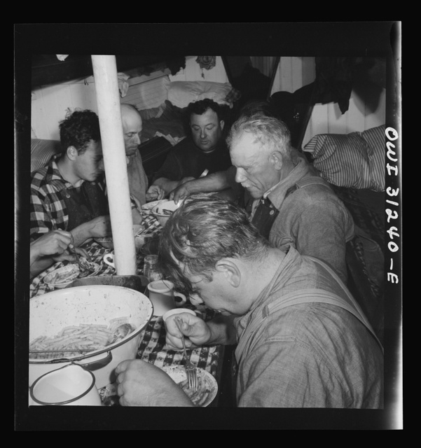 On board the fishing boat Alden, out of Gloucester, Massachusetts. Italian spaghetti is served after a hard day's work. The men eat large portions, for it may be another twelve hours before they sit down to another meal