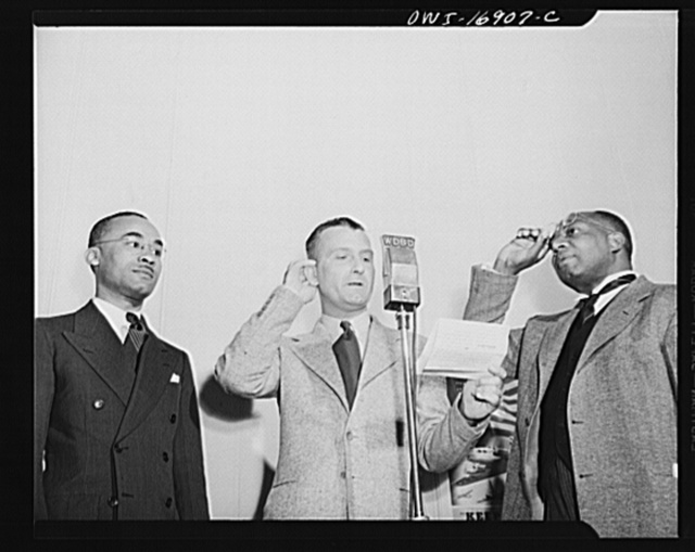 Orlando, Florida. Wings Over Jordan, a popular Sunday morning program broadcast by Columbia Broadcasting System from station WDBO. President James A. Colston waiting on the announcers, right, for his cue to begin speaking to a vast audience