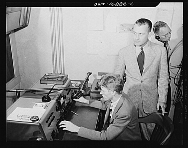Orlando, Florida. Wings over Jordan, a popular Sunday morning radio program broadcast by Columbia Broadcasting System from station WDBO. Control room checking with master station in New York to see if program is coming through clearly