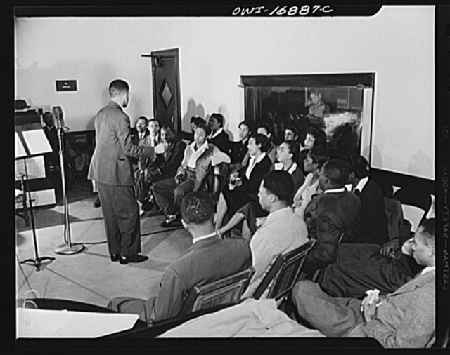 Orlando, Florida. Wings over Jordan, a popular Sunday morning radio program broadcast by Columbia Broadcasting System from station WDBO. The choir rehearsing