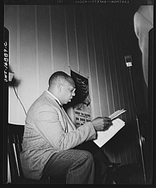 Orlando, Florida. Wings over Jordan, a popular Sunday morning radio program broadcast by Columbia Broadcasting System from station WDBO. Rev. Glenn T. Settles, founder and narrator of the program, going over his script