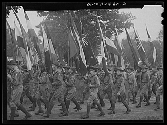 Oswego, New York. Boy scouts carrying the United Nations flags on Flag Day during United Nations week