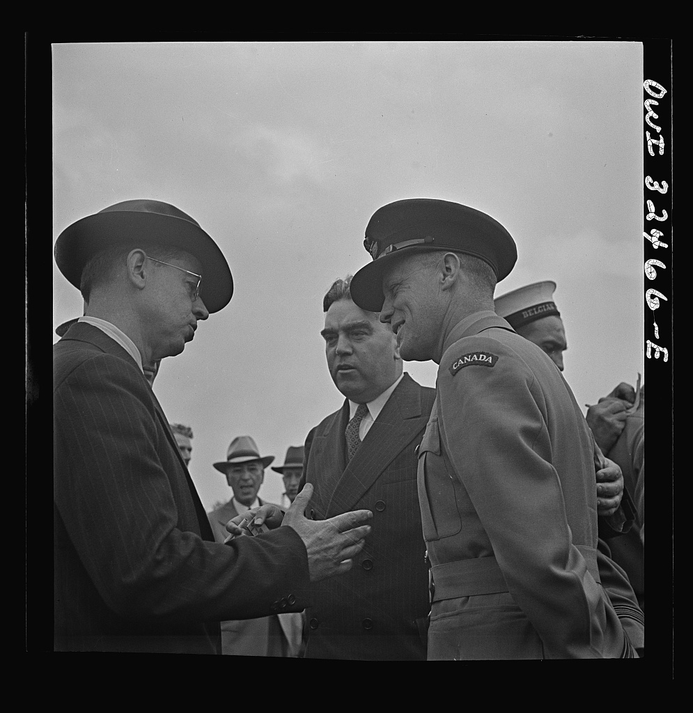 Oswego, New York. Canadian flight commander chatting with Oswegans on Flag Day during United Nations week