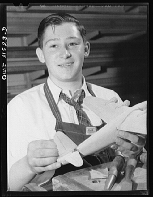 Oswego, New York. Oswego high school boy who made seventy model planes for the Navy, and was awarded honorary rank of Admiral