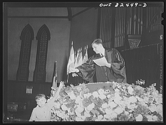 Oswego, New York. Presbyterian minister delivering the United Nations part of his Sunday service in which the children brought United Nations flags to surround the pulpit
