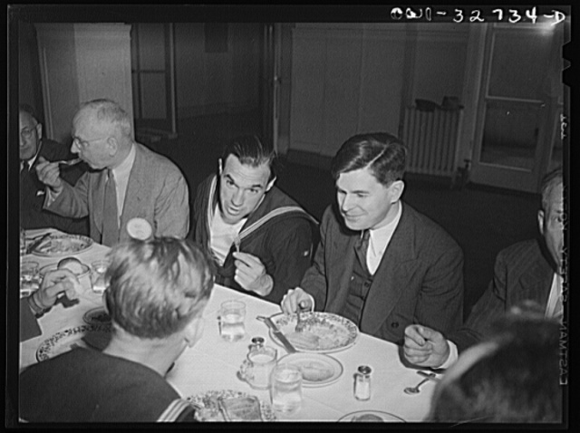 Oswego, New York. Presbyterian minister (right) and a Belgian sailor at the Rotary Club luncheon during United Nations week
