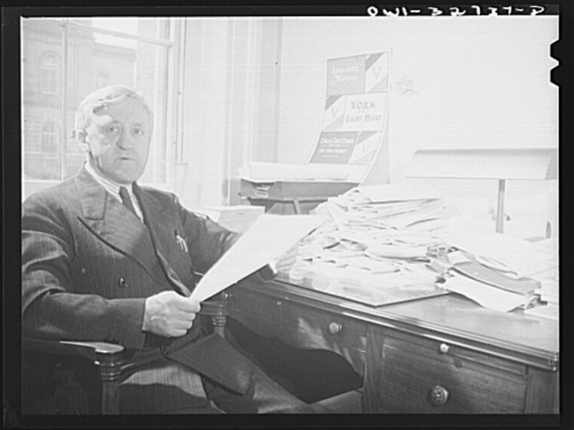 Oswego, New York. The Democrat Mayor Scanlon in his city hall office during United Nations week