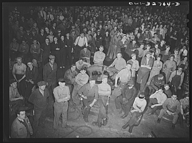 Oswego, New York. Workers in the Fitzgibbons tank factory listening to the speeches by the United Nations during United Nations week