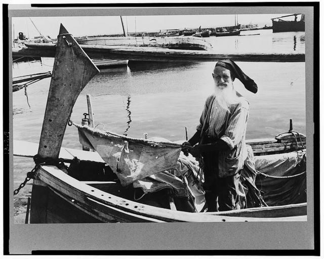 Palermo, Sicily. Fishing is encouraged by the Allied military government as one of the main sources of food for Sicilians. This fisherman is seventy-four but still sails out every day