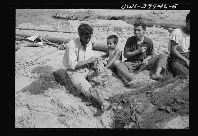 Palmero (vicinity), Sicily. A family repairing nets