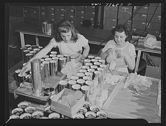 Parke, Davis and Company, manufacturing chemists, Detroit, Michigan. Putting on slings for suspending bottles of blood plasma