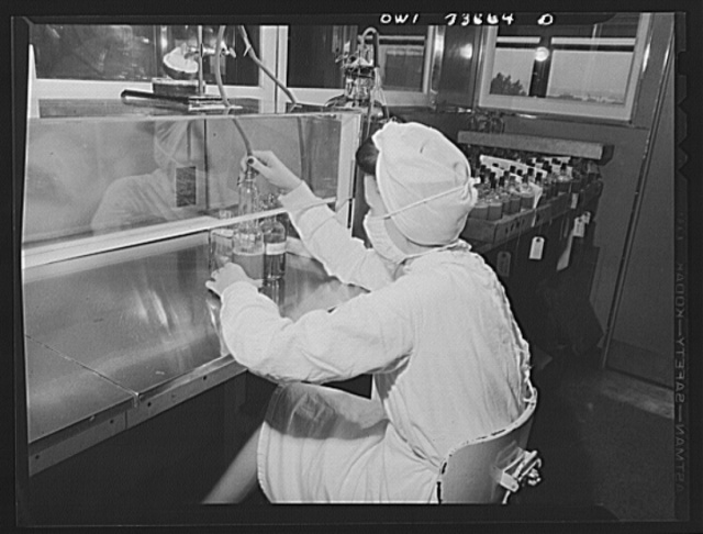 Parke, Davis and Company, manufacturing chemists, Detroit, Michigan. Siphoning blood plasma into glass containers