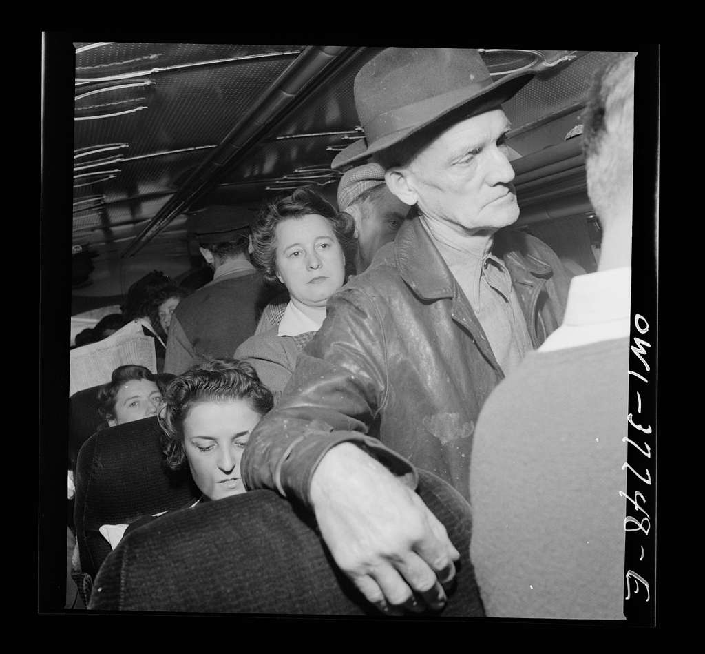 Passengers on a Greyhound bus going from Chicago, Illinois to Cincinnati, Ohio. Most of the standing passengers are local fares going from their farms to town