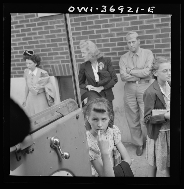 Passengers waiting for a Greyhound bus driver to start loading them on the bus at a small town in Pennsylvania
