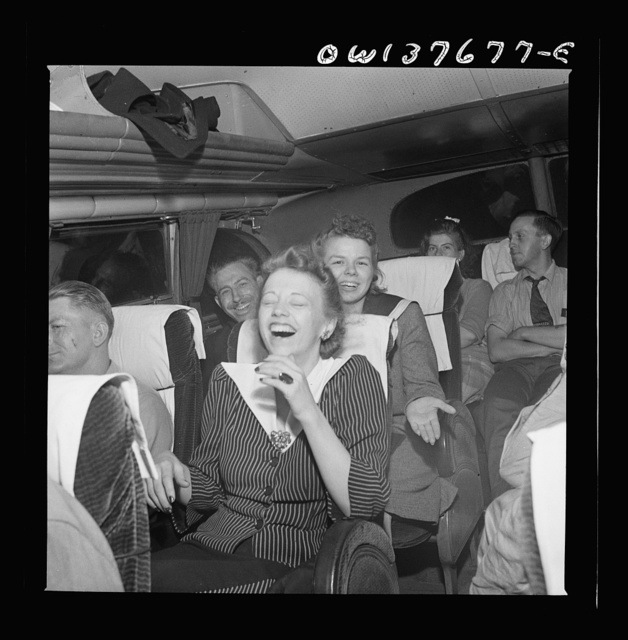 """Passengers, who have struck up a friendship on a Greyhound bus en route from Pittsburgh, Pennsylvania to St. Louis, Missouri, telling """"moron"""" jokes"""