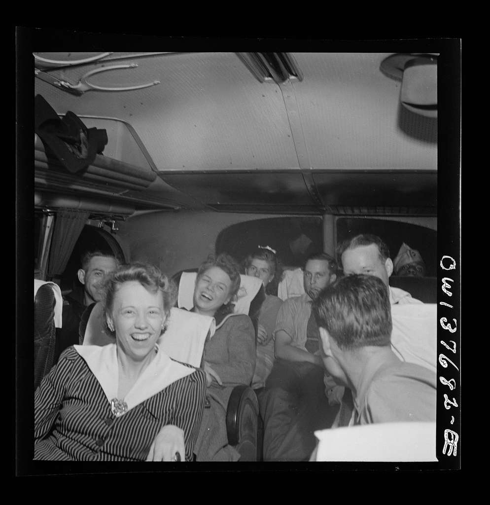 "Passengers who have struck up a friendship on a Greyhound bus enroute from Pittsburgh, Pennsylvania to Saint Louis, Missouri telling ""moron"" jokes"