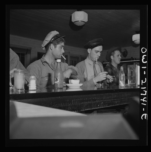 Pearlington (vicinity), Mississippi. Truck drivers at a highway coffee stop on U.S. Highway 90