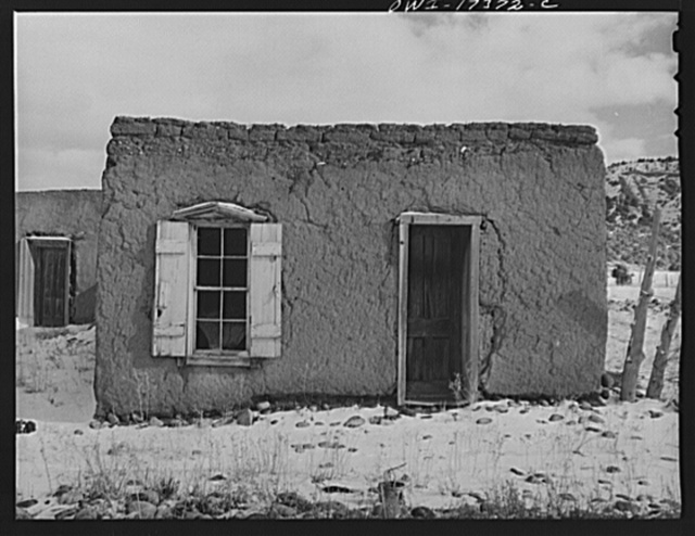 Penasco, New Mexico. Adobe houses last well when lived in, but decay quickly when vacated