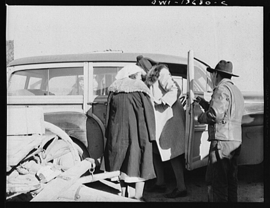 Penasco, New Mexico. An obstetrical case being rushed to the hospital at Embudo