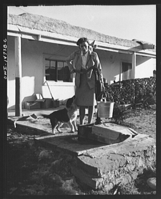 Penasco, New Mexico. Marjorie Muller, nurse from the clinic operated by the Taos County cooperative health association, chops her own wood, draws her own water, scrubs and polishes, and does her own cooking