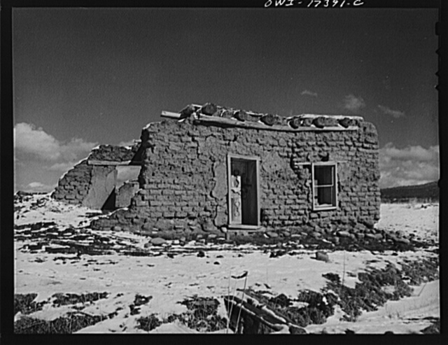 Penasco, Taos County, New Mexico. Adobe houses are nearly indestructible when lived in, but rapidly decay when abandoned