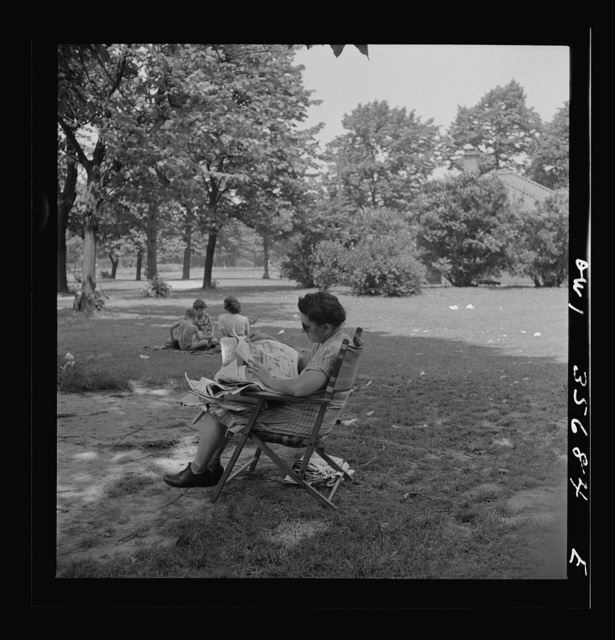 Philadelphia, Pennsylvania. A woman and children in the shade of the trees at Fairmont Park