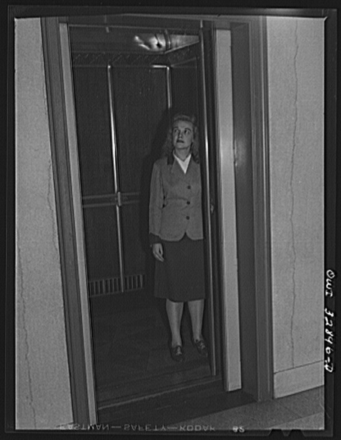 Philadelphia, Pennsylvania. Miss Dorothy Eyster, an elevator operator at a downtown office building