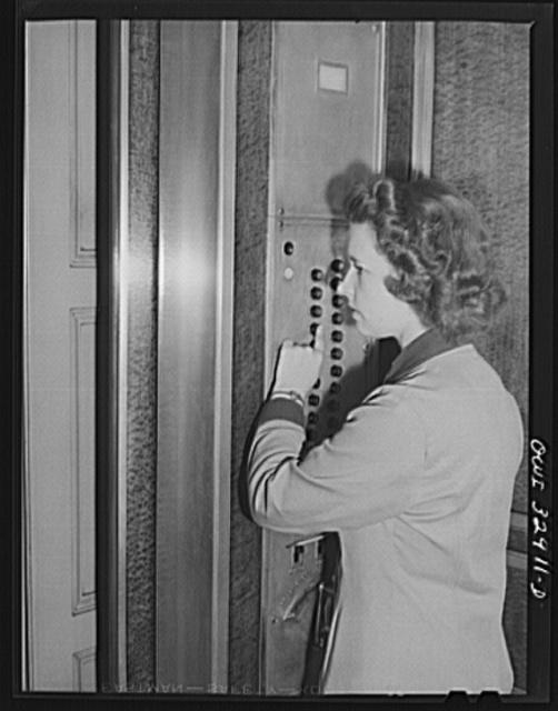 Philadelphia, Pennsylvania. Miss Jane Sherwood, an elevator operator at a downtown office building