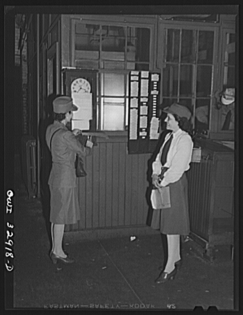 Philadelphia, Pennsylvania. Mrs. Abbie Corby (left) and Mrs. Suzanne O'Donnell drivers for the Yellow Cab Company